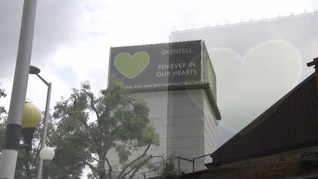 Survivors and relatives launch lawsuit against cladding manufactures ENGLAND London North Kensington EXT Green leaves and Grenfell Tower covered in...