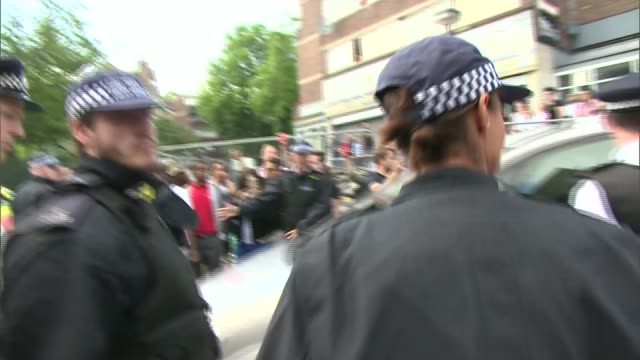 theresa may booed as leaving local church crowd view england london north kensington st clement's church shots from crowd police officers... - shaky stock videos & royalty-free footage