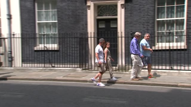 Theresa May meets survivors in Downing Street Downing Street Families from Grenfell Tower along to 10 Downing Street