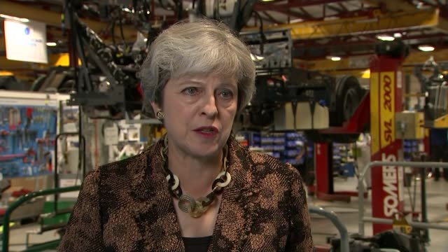 theresa may says management organisation may lose responsibility for running the estate england surrey guildford alexander dennis factory int theresa... - guildford stock videos and b-roll footage