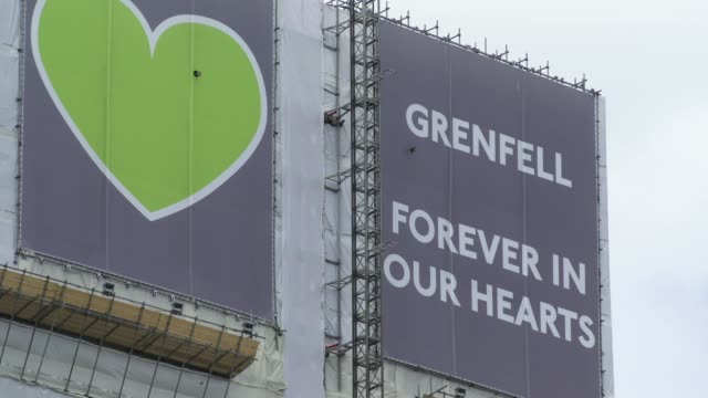 grenfell tower is seen, covered in a safety tarpaulin in west london on june 14 on the third anniversary of the high-rise fire that killed 71 people.... - domestic kitchen stock videos & royalty-free footage