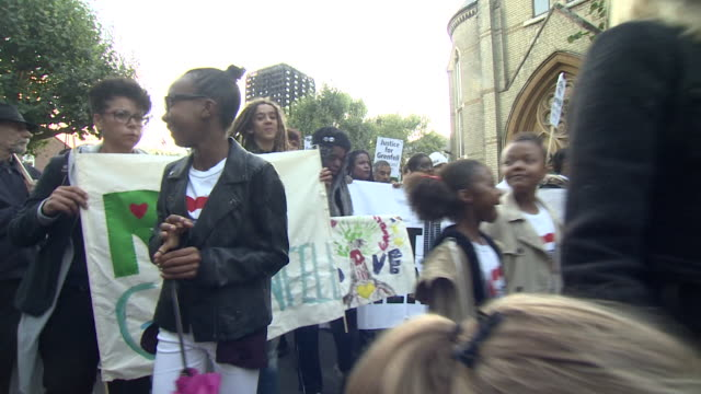 grenfell tower residents marching in silence at the start of the official inquiry - marching stock videos & royalty-free footage