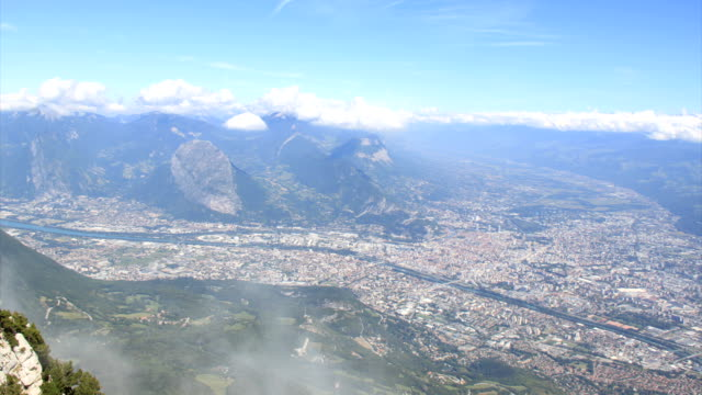 Grenoble between the clouds HD.