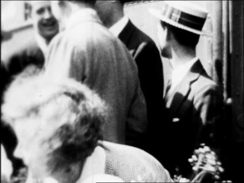 greta garbo with large bouquet of flowers hugging children / arrival in hollywood / newsreel - 1926 stock videos & royalty-free footage
