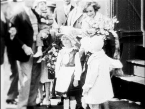 greta garbo with large bouquet of flowers posing with children / hollywood / newsreel - 1926 stock videos & royalty-free footage