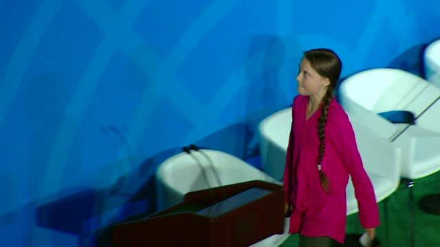 stockvideo's en b-roll-footage met greta thunberg climate change activist leaves stage after speech at climate action summit 2019 at the un new york - united nations