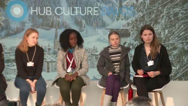 greta thunberg leads school strike in davos as wef summit comes to a close switzerland davos int gv panel featuring greta thunberg as reporter asking... - ダボス点の映像素材/bロール