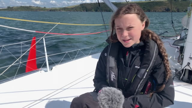 greta thunberg saying her sailing trip from plymouth to new york will uncomfortable but she can live with it - carbon footprint stock videos and b-roll footage