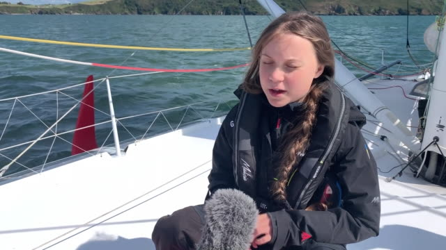 "greta thunberg saying the reason for her sailing trip from plymouth to new york is to ""create an opinion"" about reducing one's carbon footprint - nautical vessel stock videos & royalty-free footage"