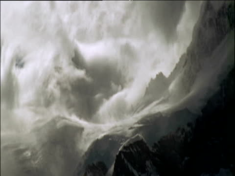 Grey and white snow swirls in avalanche
