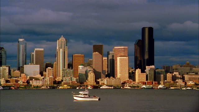 grey clouds create shadows on the seattle skyline. - washington mutual tower stock videos & royalty-free footage