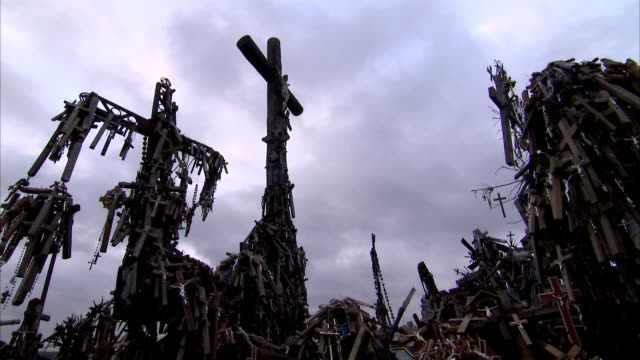 grey clouds drift above the hill of crosses. available in hd. - lithuania stock videos & royalty-free footage