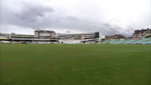 Grey clouds hang over The Oval cricket ground. Available in HD.