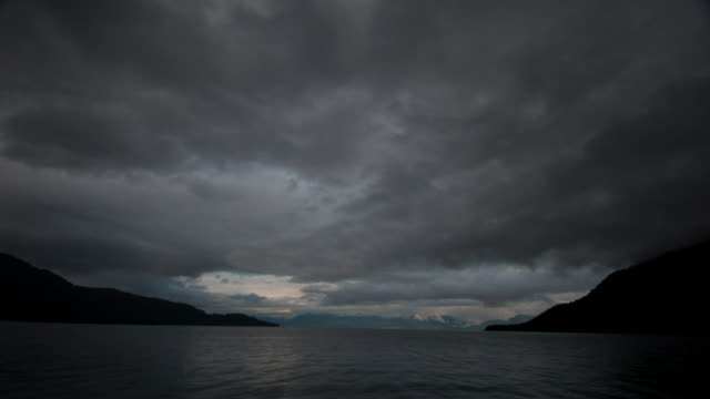 Grey clouds pass over inlet.