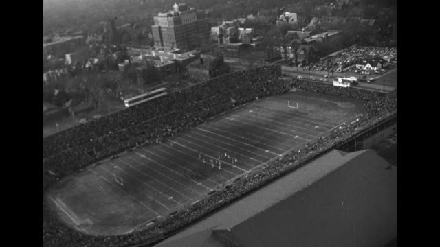 grey cup trophy superimposed over traffic in street in toronto / aerial shot of varsity stadium / governor general of canada vincent massey enters... - politician stock videos & royalty-free footage