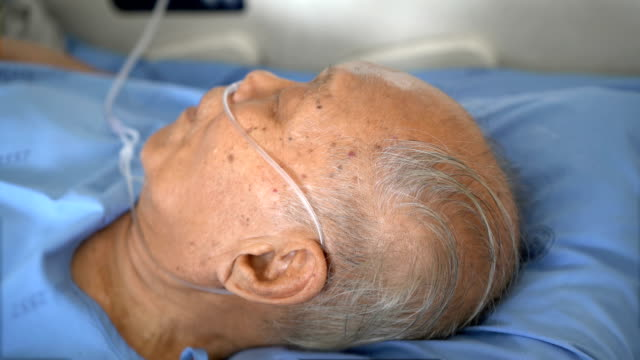 grey hair senior male patient sleeping in hospital - oxygen stock videos & royalty-free footage