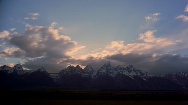 Grey storm clouds pass over Mount Moran in Grand Teton National Park, Wyoming.