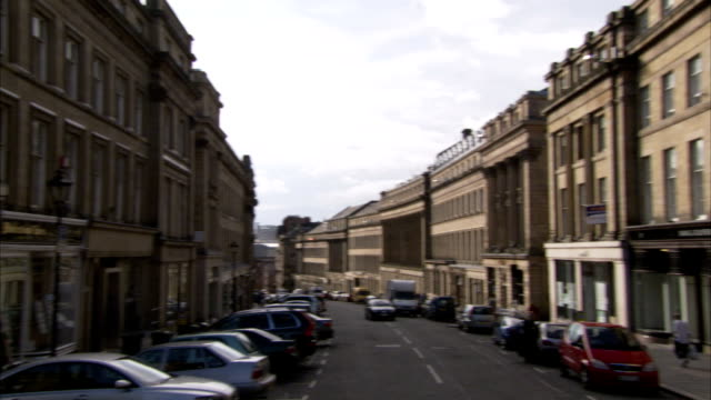grey street lined with beautiful victorian buildings in newcastle upon tyne. available in hd. - newcastle upon tyne stock-videos und b-roll-filmmaterial