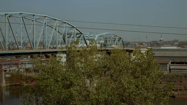 a greyhound bus crosses a bridge in nashville, tennessee. - tennessee stock videos & royalty-free footage