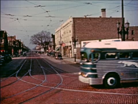 1941 greyhound bus passing camera on town street / chicago / industrial - 1940~1949年点の映像素材/bロール