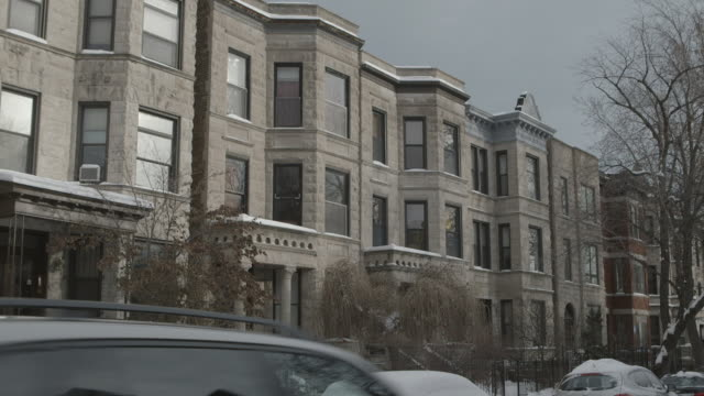 WS Greystone apartments on residential street in winter