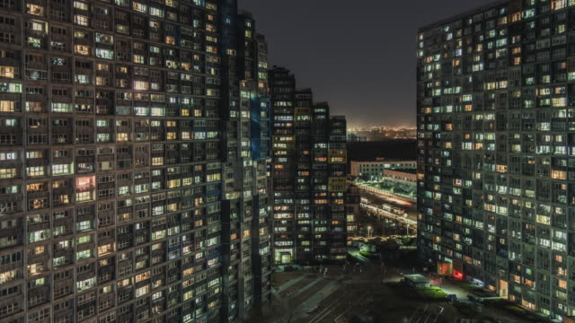 t/l ha pan grid apartment / beijing, china - population explosion stock videos and b-roll footage