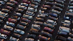 Grid of Cars in Scrapyard at Sunset - Drone Shot