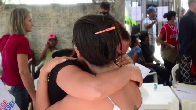 grieving families wait at a police morgue in northwestern brazil as the slow process continues to identify bodies after gang fights between inmates... - prison riot stock videos & royalty-free footage
