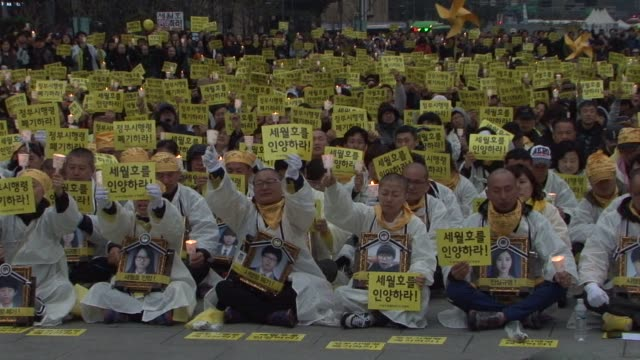 grieving relatives of the victims of last years south korean ferry sinking complete a 46 kilometre marathon march sunday to call for an independent... - kilometre stock videos & royalty-free footage