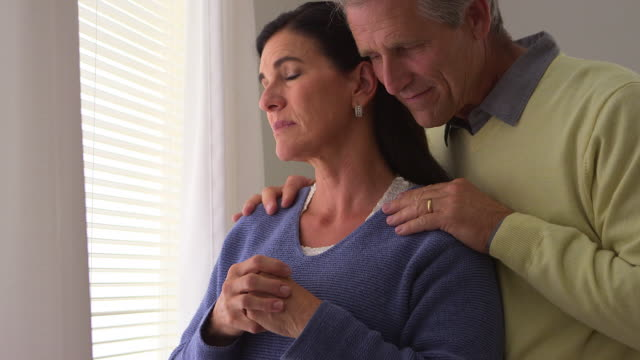 grieving wife being comforted by husband - husband stock videos & royalty-free footage