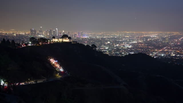 griffith observatory and los angeles skyline at night - griffith observatory stock videos & royalty-free footage