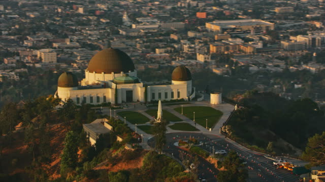 aerial griffith observatory in the early morning sun - griffith observatory stock videos & royalty-free footage
