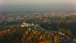 AERIAL Griffith Observatory overlooking the city of Los Angeles in the morning sun