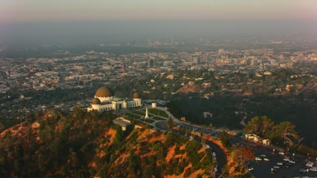 aerial griffith observatory overlooking the city of los angeles in the morning sun - real time stock videos & royalty-free footage