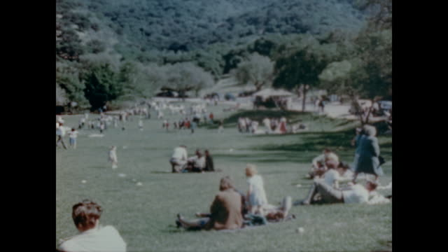 1947 griffith park is filled with thousands of visitors daily - picnic stock videos & royalty-free footage