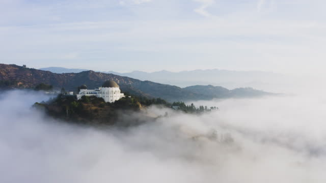 griffith park observatory and the hollywood hills at sunrise - griffith observatory stock videos & royalty-free footage