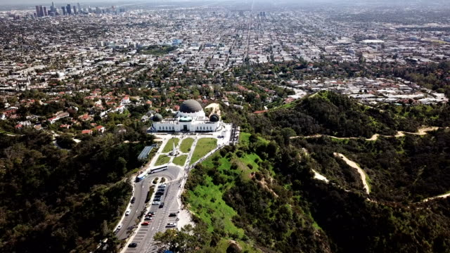 griffith park observatory in the hollywood mountains near los angeles ca - griffith observatory stock videos & royalty-free footage