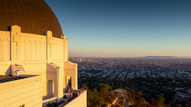 griffith park observatory, los angeles - day to dusk time lapse - day to dusk stock videos & royalty-free footage