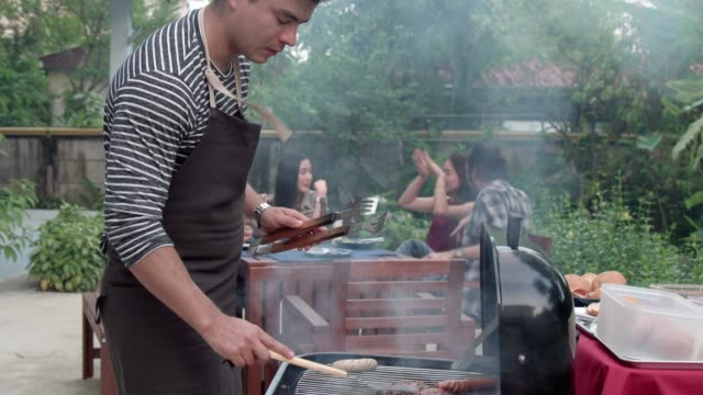 bbq grill, group of friends having outdoor barbeque at home - caucasian ethnicity video stock e b–roll