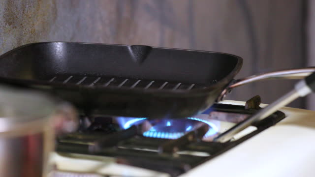 Grill pan on gas stove.