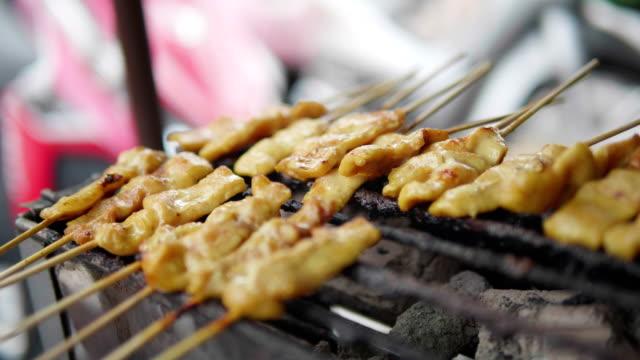 grill pork satay, street food, thailand. concept : street food , travel. - roast beef stock videos & royalty-free footage