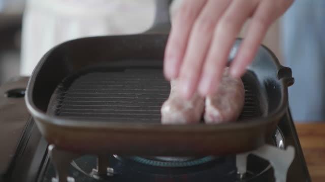 grill pork sausage on griddle pan - sausage stock videos & royalty-free footage