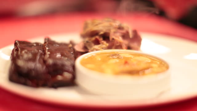 grilled barbecue ribs, brisket and beans - brisket stock videos and b-roll footage