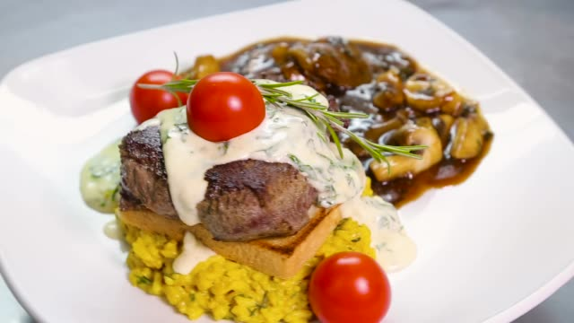 grilled beef meat with mushrooms on a plate - gourmet stock videos & royalty-free footage