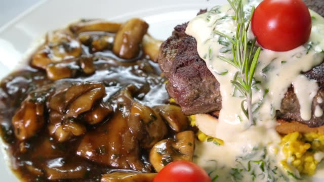 grilled beef meat with mushrooms on a plate - risotto stock videos & royalty-free footage