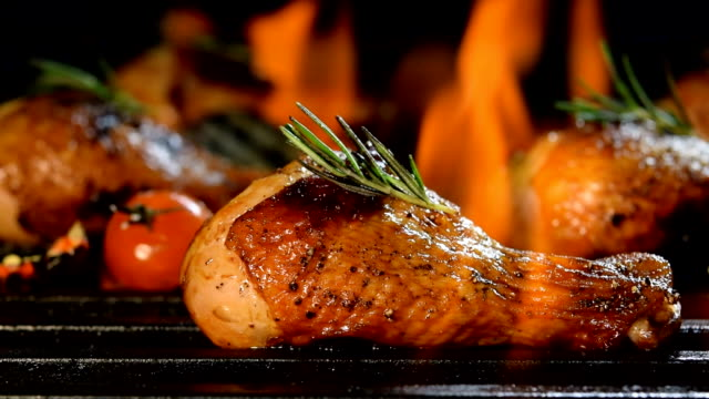 grilled chicken legs on the flaming grill - grilled chicken stock videos and b-roll footage