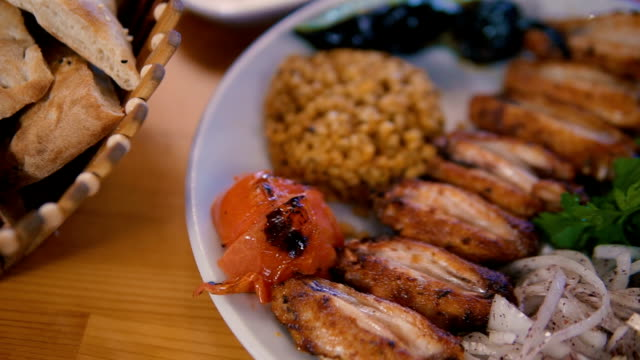 grilled chicken wings on a plate - table top view video stock e b–roll