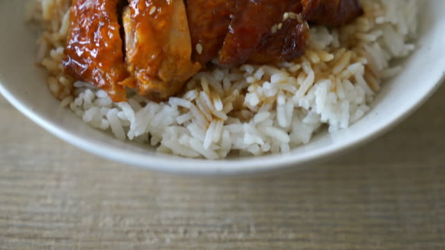 grilled chicken with teriyaki sauce on topped rice - meal stock videos and b-roll footage