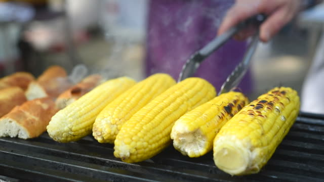 grilled corn on the stove on the market. grilled corn - corn cob stock videos & royalty-free footage