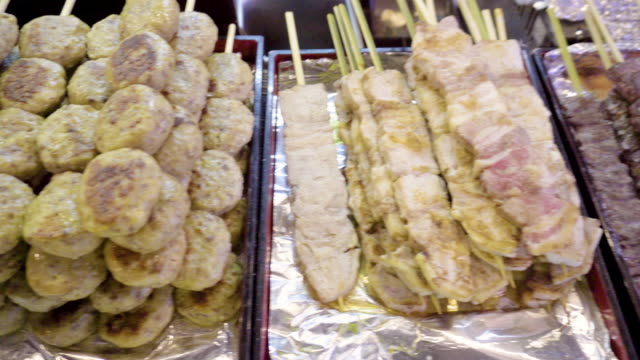 grilled hamburger pork stick - market stall stock videos & royalty-free footage